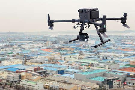 Industrial drone flies over factories Reklamní fotografie