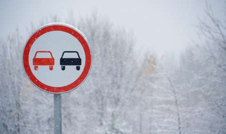 No overtaking sign on the winter road