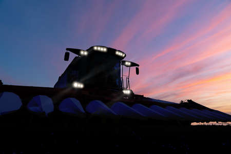 Combine harvester at night