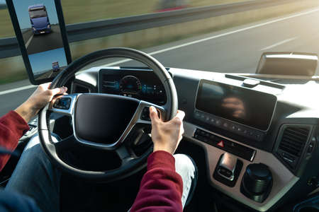 Man driving a truck with rear view camera