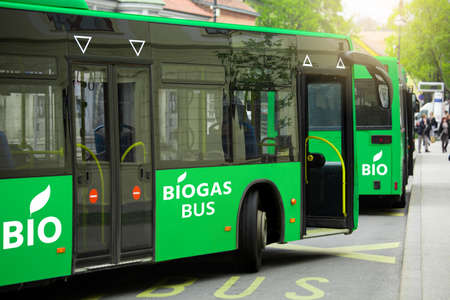 Buses powered by biogas on a city street. Carbon neutral transportation concept Stock fotó