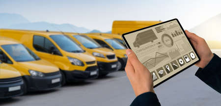 Manager with a digital tablet on the background of vans. Fleet management Stockfoto