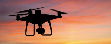 Silhouette of a drone on a sunset background Stockfoto