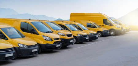 Yellow delivery vans parked in a row