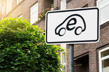 Sign with electric car symbol
