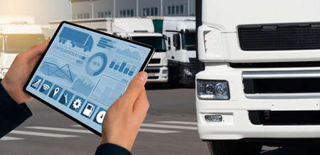 Fleet manager with a digital tablet Stock Photo