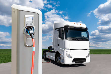 Electric vehicles charging station on a background of a truck