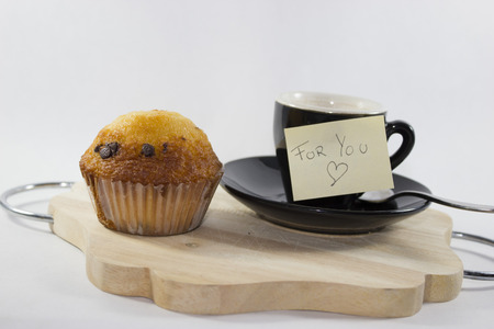 espresso coffee on tray with milk chocolate muffin with white background Stock Photo