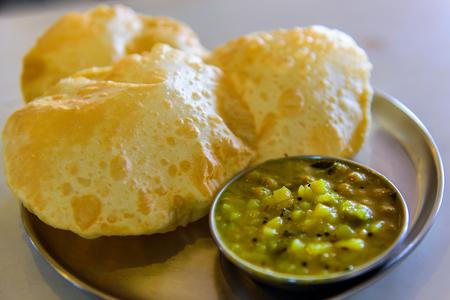 traditional indian vegeterian meal puri bhaji