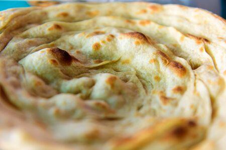 Lacha paratha, puff pastry. Traditional Indian flat bread paratha, close up.