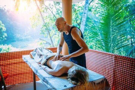 Fake massage. Funny masseur fooling around and grimacing, can not do massage. Not a professional back massage. Reklamní fotografie