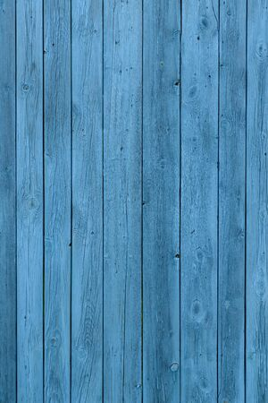 Blue wooden background, old age effect. Old boards painted light blue, close-up. Vertical image. 版權商用圖片