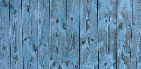Painted old vintage blue and grey wooden textured wall, close up. Vintage background. Copy space.