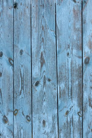 Painted old vintage blue and grey wooden textured wall, close up. Vintage background. Vertical image. 版權商用圖片