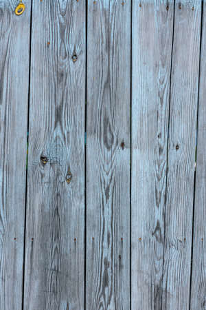 Wood grunge, stained background with space for text or image. Vintage background from gray wooden vertical shabby plank.