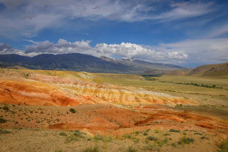 Amazing natural phenomenon-Martian landscapes in the Altai mountains. Multicolored rocks against a blue sky with white clouds. Futuristic panoramic picture, background image. Mars. 版權商用圖片 - 156939175