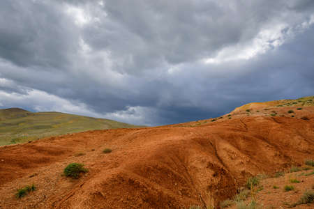 Martian landscape, natural landmark of Altai Republic. Mountains colored red, yellow, and orange against a blue sky with white clouds. 版權商用圖片