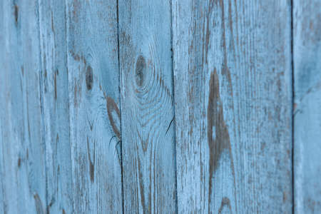Painted old vintage blue and gray wooden textured wall, close up. Vintage background. Copy space.