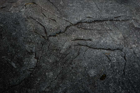 Dark gray stone texture. Industrial design background. Abstract grunge. Old rough black granite surface. Image with copy space. Banque d'images