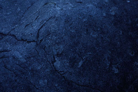 Dark blue stone texture. Industrial design background. Abstract grunge. Old rough black granite surface. Image with copy space.
