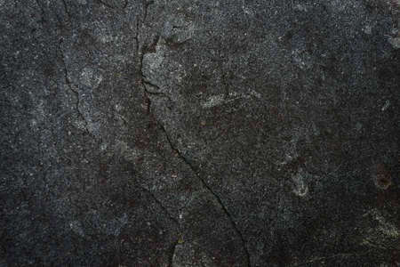 Dark gray stone texture. Industrial design background. Abstract grunge. Old rough black granite surface. Image with copy space. 版權商用圖片
