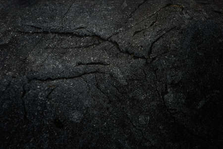 Black stone background. Cement, concrete grunge. Background blank for design. Dark gray wall texture.
