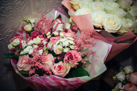 Luxury bouquets of fresh pink and white roses, close-up. Flowers for a wedding celebration. Flower arrangement.