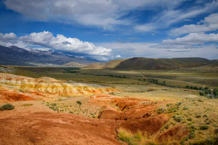 Natural attraction of Altai mountains, Martian landscapes. Stunning panorama with a ridge of rocks against a blue sky with white clouds. Popular tourist routes in Russia.