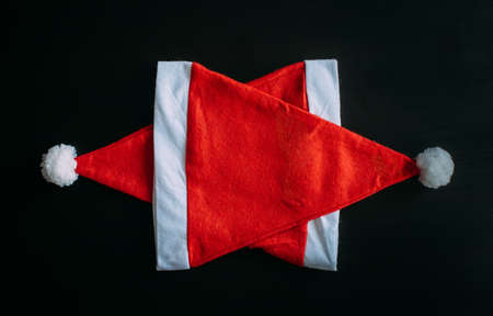 Santa Claus hats on top of each other. Pentagonal star making from Santa Claus hats. New year's concept, Christmas background.