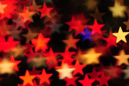 christmas bulbs: colorful bokeh stars background