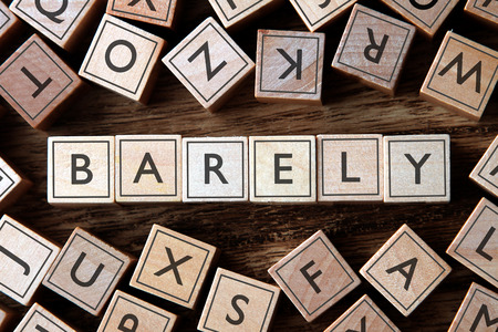 barely: the word of BARELY on building blocks concept