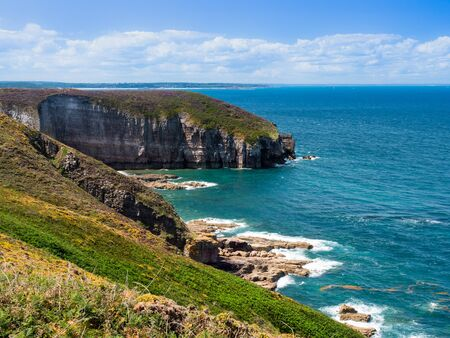 A scenic view of the cliffs on a coast of the Atlantic ocean.