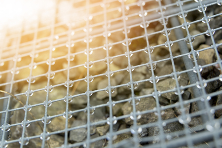 Mesh gabions with water drops