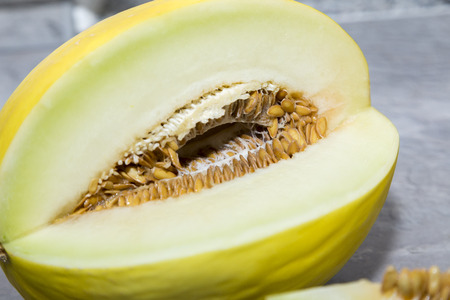 whole and slice of  melons, chopped with seeds  Stock Photo
