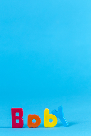 Baby multicolored letters on a blue background