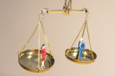 Depicted in a conceptual image by  a seesaw showing the male and female genetic symbols in equilibrium. Equality between the sexes.   Feminism and equality