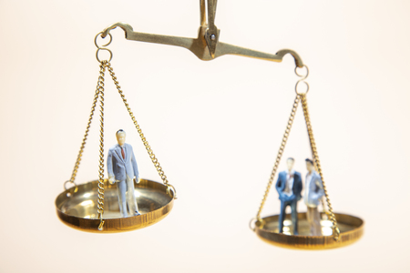 Balance between boss and employee on gold scale