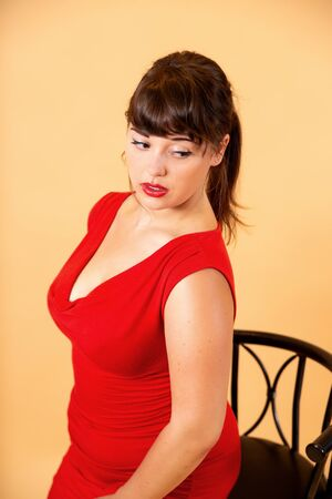 portrait of a smiling brunette in a red dress Imagens