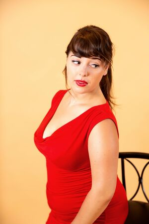 portrait of a smiling brunette in a red dress Standard-Bild