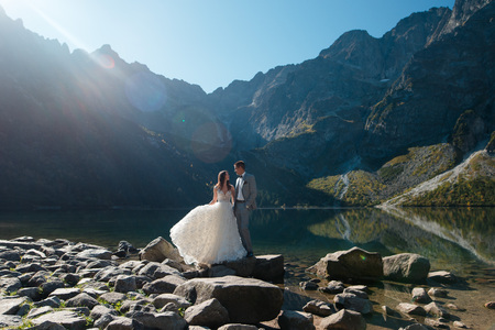 Young wedding couple walking near the lake in Tatra mountains in Poland. Morskie Oko. Beautiful summer day