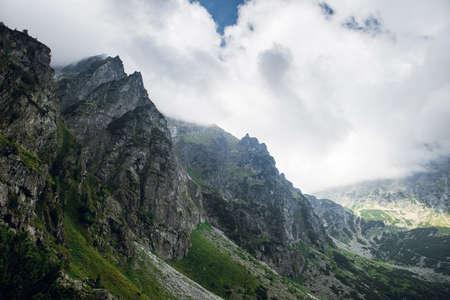 Scenic view of sharp rocky mountain peaks in the dark clouds near the Morskie Oko lake, High Tatras, Zakopane, Poland Фото со стока