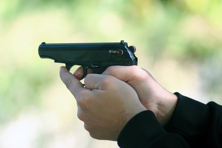 bb gun: Shooting with the a gun with two hands Stock Photo