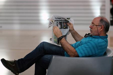 Portrait Of serius Mature Man Reading Newspaper. Spain