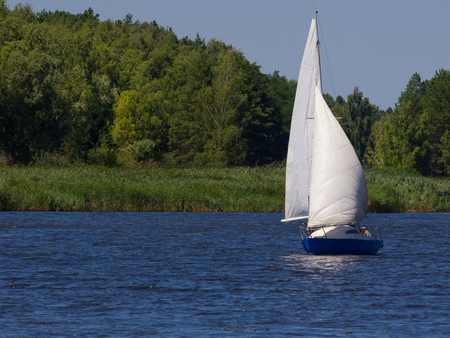 dnepr: yacht with white sails in river Dnepr, Ukraine Stock Photo