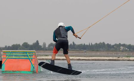 wakeboarding: Wakeboarder making tricks. Wakeboarding on the beach.