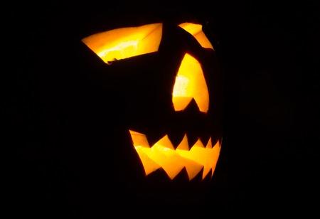 helloween: BIg real luminous scary helloween pumpkin on the grass