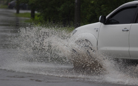 rain weather: CHERKASSY, UKRAINE- JUNE 27, 2015: cars driving on a flooded road during a flood caused by heavy rain, in Cherkassy. Editorial