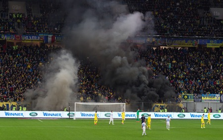 disrupted: LVIV, UKRAINE - NOWEMBER 14:Terrorists fans disrupted a football match between the national teams of Ukraine and Slovenia burning and explosion of fireworks packages. Bate on Nowember 14, 2015 in Lviv, Ukraine Editorial