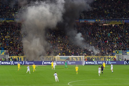 ultras: LVIV, UKRAINE - NOWEMBER 14:Terrorists fans disrupted a football match between the national teams of Ukraine and Slovenia burning and explosion of fireworks packages. Bate on Nowember 14, 2015 in Lviv, Ukraine Editorial