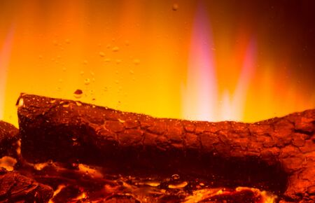 burning fireplace: a drop of water from the steam from the burning fireplace Stock Photo